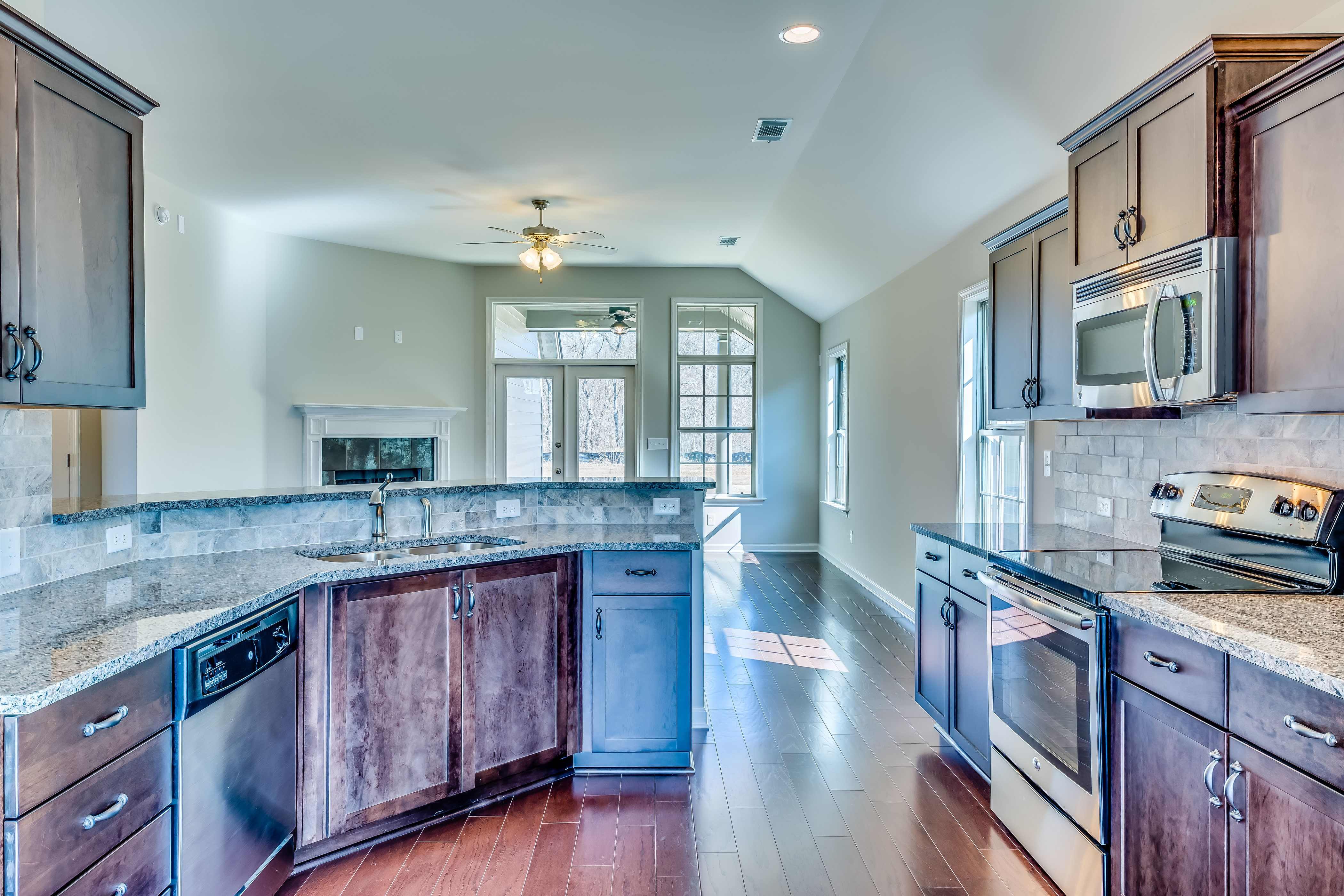 Gorgeous open concept kitchen with views into the living room along ...