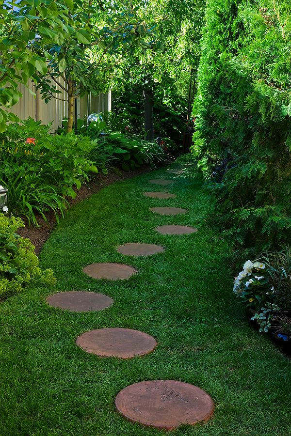 Stepping stone paths on pinterest stepping stone for Paving designs for small garden path
