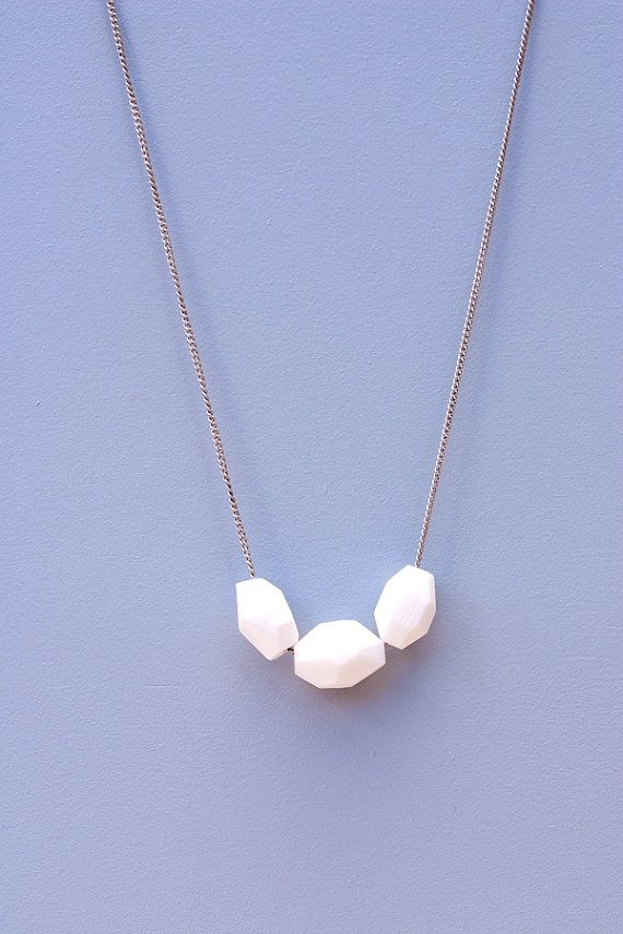 A graceful string of hand-carved Corian beads on antiqued silver chain makes a beautiful statement. The cool crisp forms make up the Artic Bead Necklace by Brave Space Design. These gems salvaged in the making of furniture feature versatile tones and texture.  Variations in material and shape should be expected from what is shown in the images as every piece is made by hand.