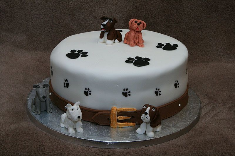 White Dog Birthday Cake With Dogs And Paws
