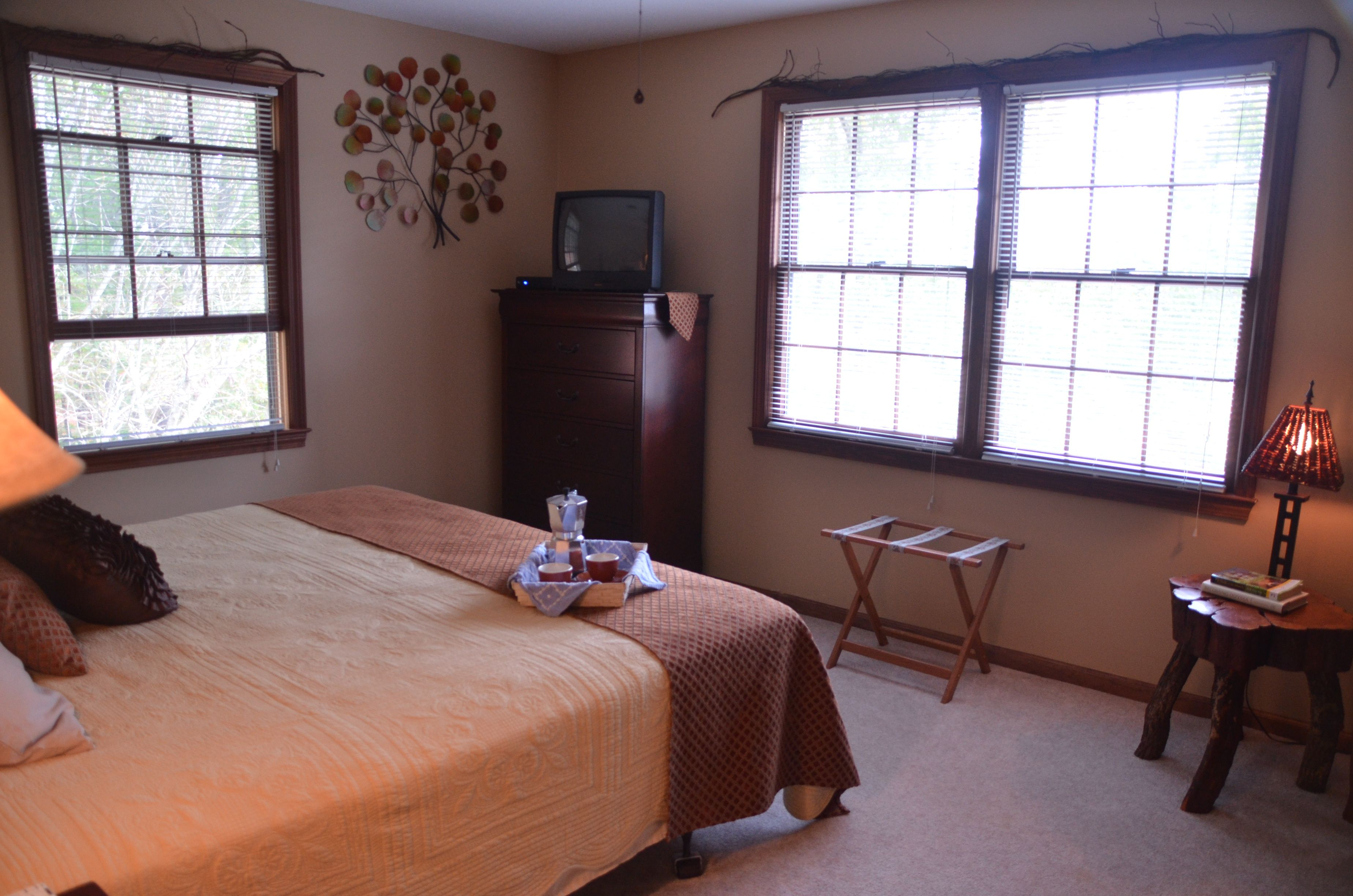 Master bedroom with a king size bed, Direct TV and a small