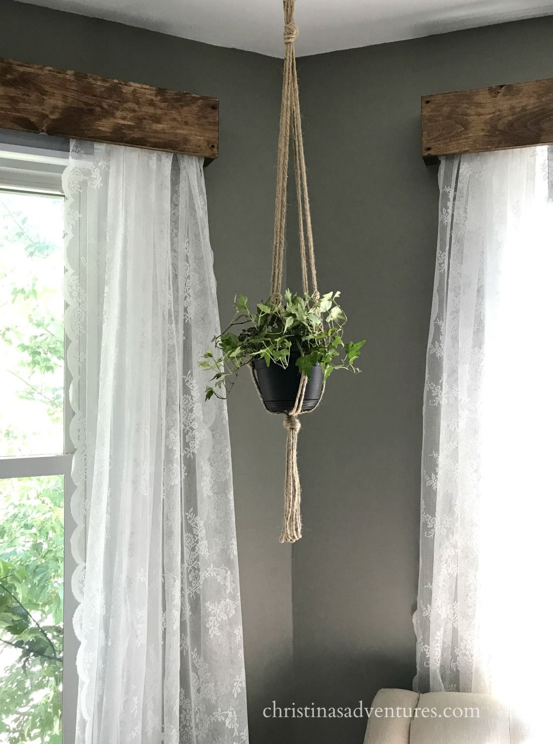 This DIY wood window valance pairs beautifully with lace curtains