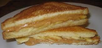 Fried Peanut Butter and Banana Sandwich    Spread 2 slices of white bread  with 2 heaped tablespoons of smooth peanut butter  and half a very ripe mashed banana.  Fry the sandwich until brown on both sides.  Serve warm. (Use a knife and fork to eat it.)