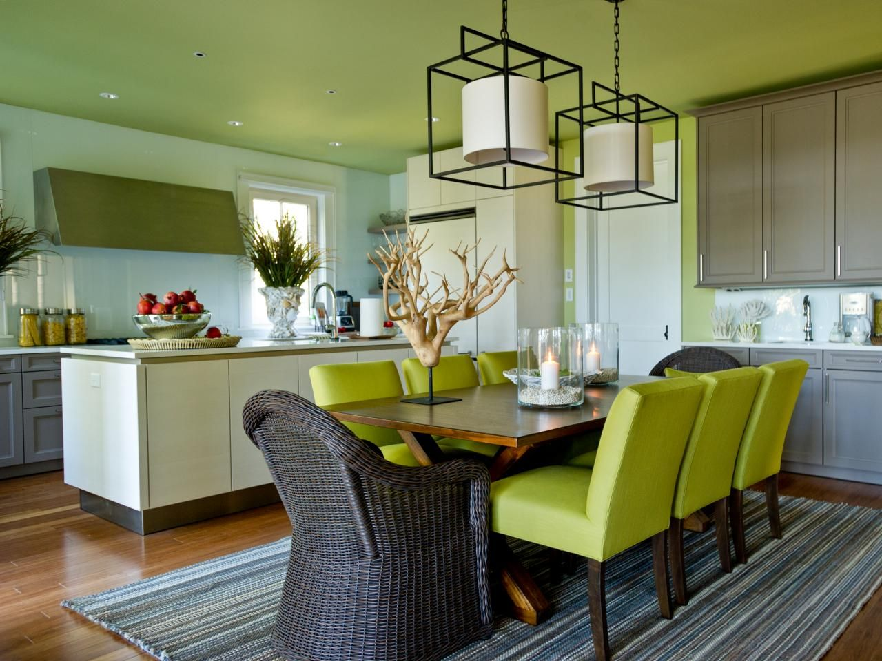 A Braided Rug Anchors This Contemporary Style Dining Area Where Trestle Table Fashioned From Mindi Wood Becomes Its Own Focal Point When