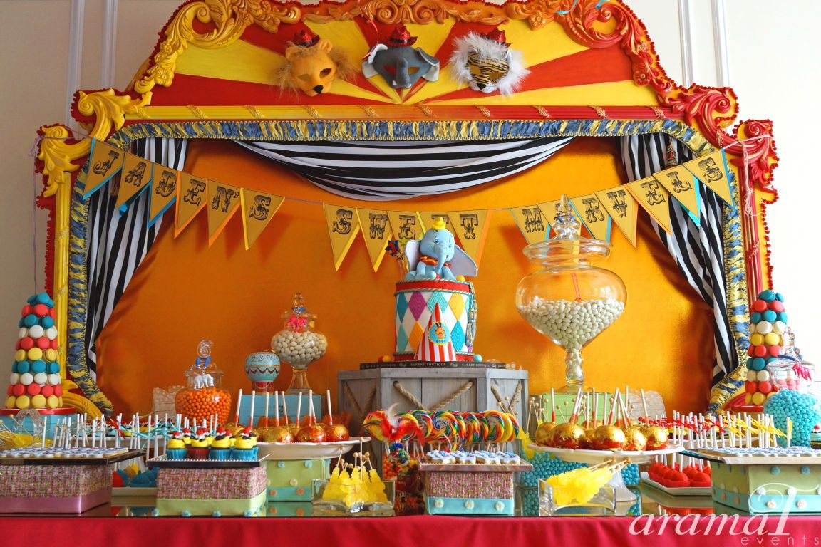 Its A Vintage Circus Themed Dessert Bar For Little Boys 1 Year Old Birthday Party We Love The Colorful Macaroons Gold Glittered Candy Apples