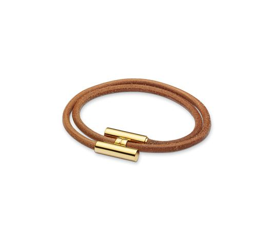 "Tournis Hermes leather bracelet Natural cowhide  Gold plated hardware, 2.75""diameter, 7.5"" circumference."