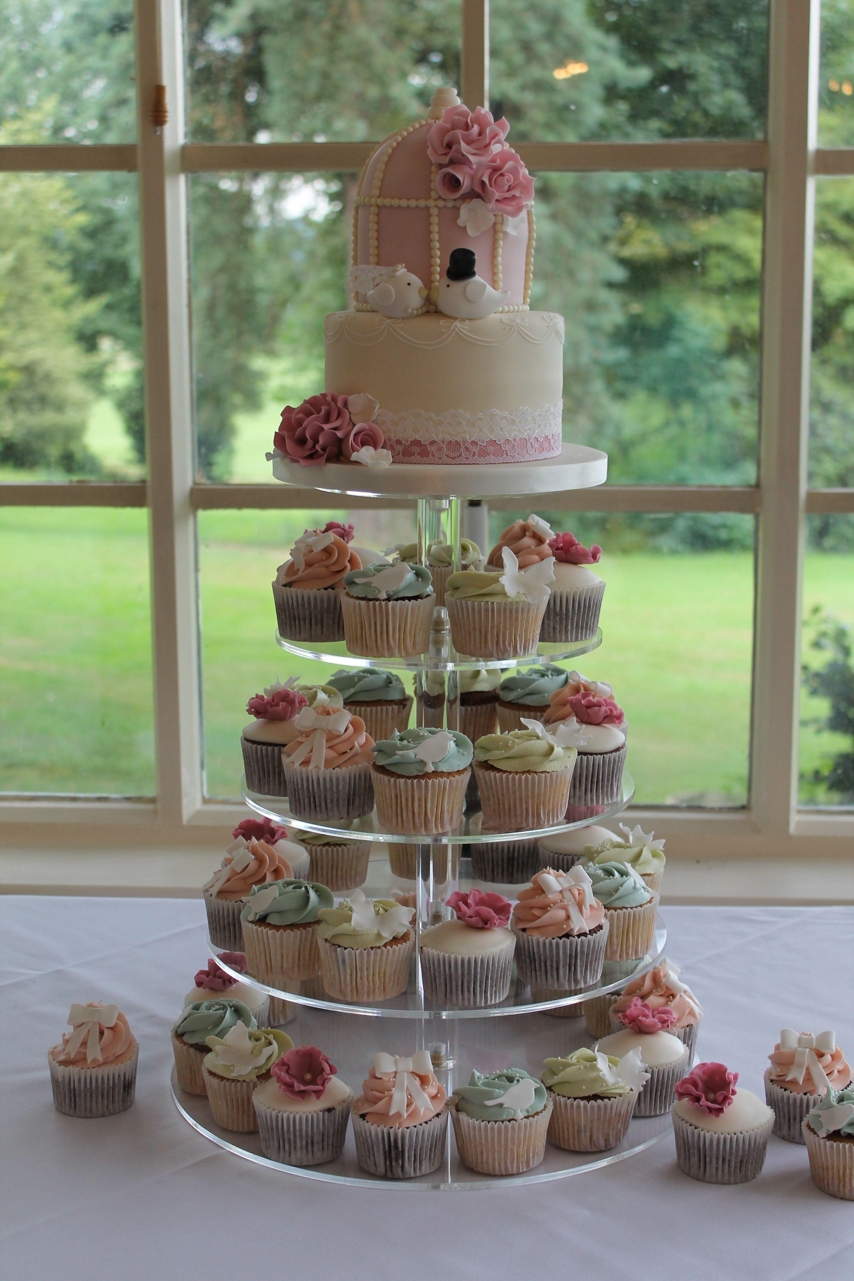 Birdcage wedding cake with love bird bride and groom