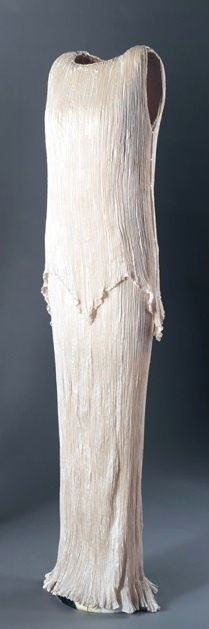 Delphos Dress, Mariano Fortuny (Spanish, 1871-1949): 1920's, pleated silk.  Fortuny worked with a few simple ideas and shapes, from which he drew countless variations, never creating the same dress twice. The pleated silk Delphos gown, patented in 1907, and the long gown and jacket were designed shortly thereafter. All were designs he repeated with subtle variation until his death in 1949... Originally intended for wear in the home as tea gowns without undergarments...