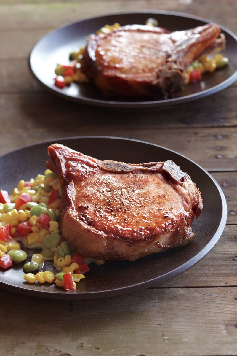 Smoked pork chops are like ham on a bone; they're purchased fully cooked and seasoned, so you don't need to add salt. Just warm them up, and they are ready to serve. Reserve the end cut of a smoked...