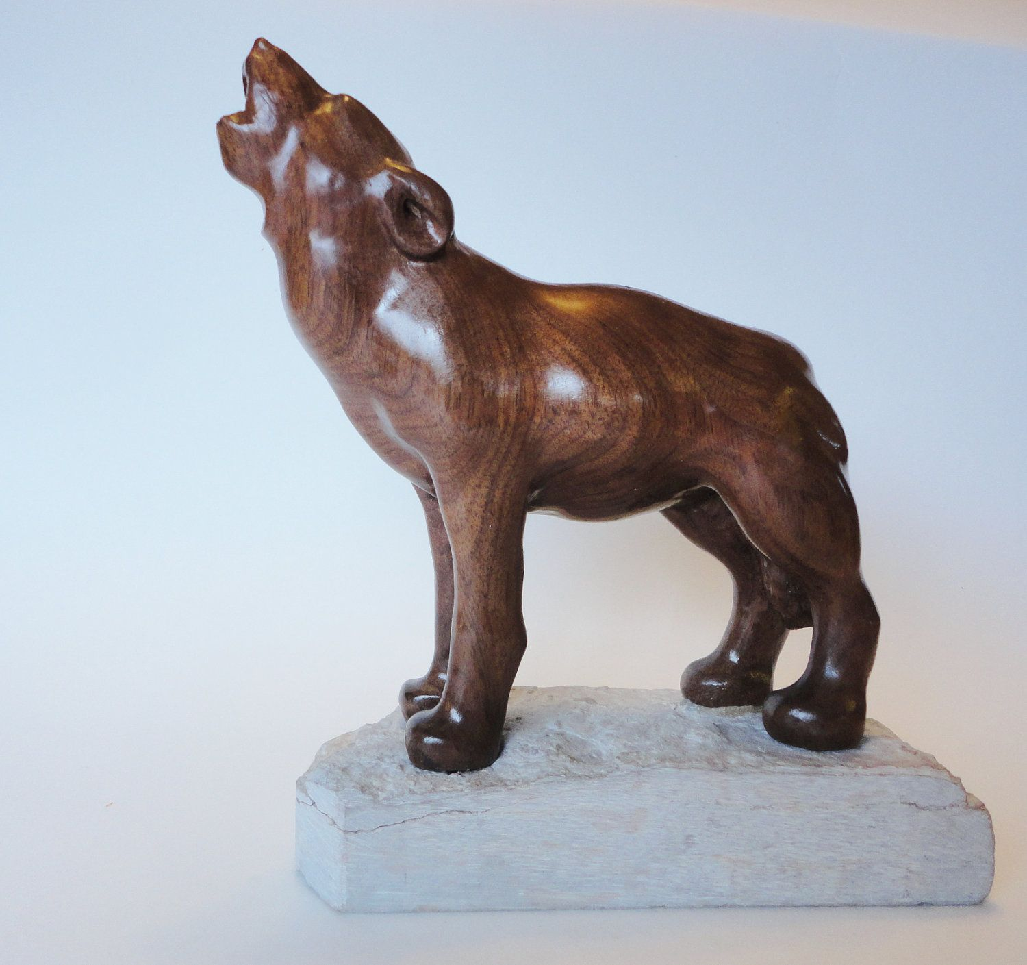 Howling wolf wood carving in black walnut by