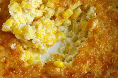 Corn Pudding - Box of Jiffy Corn Bread Mix, Can of whole kernel corm with water, can of cream style corn, 6 oz of sour cream and a stick of partially melted butter.  Mix all together and back at 400 degrees for 1 hour.