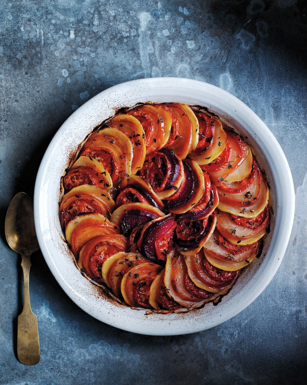 Autumn Tian | Martha Stewart Living - Time to show off those knife skills! Even slices of beets, potatoes, and tomatoes are key to this colorful side dish.
