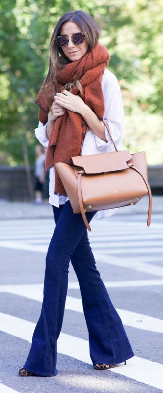 Arielle Nachami wears an oversized rust coloured scarf with ultra cool denim flares and leopard print heels.   Jeans: L'Agence, Shirt: Elizabeth and James, Scarf: Zara, Bag: Celine, Sunglasses: Miu Miu.... | Style Inspiration