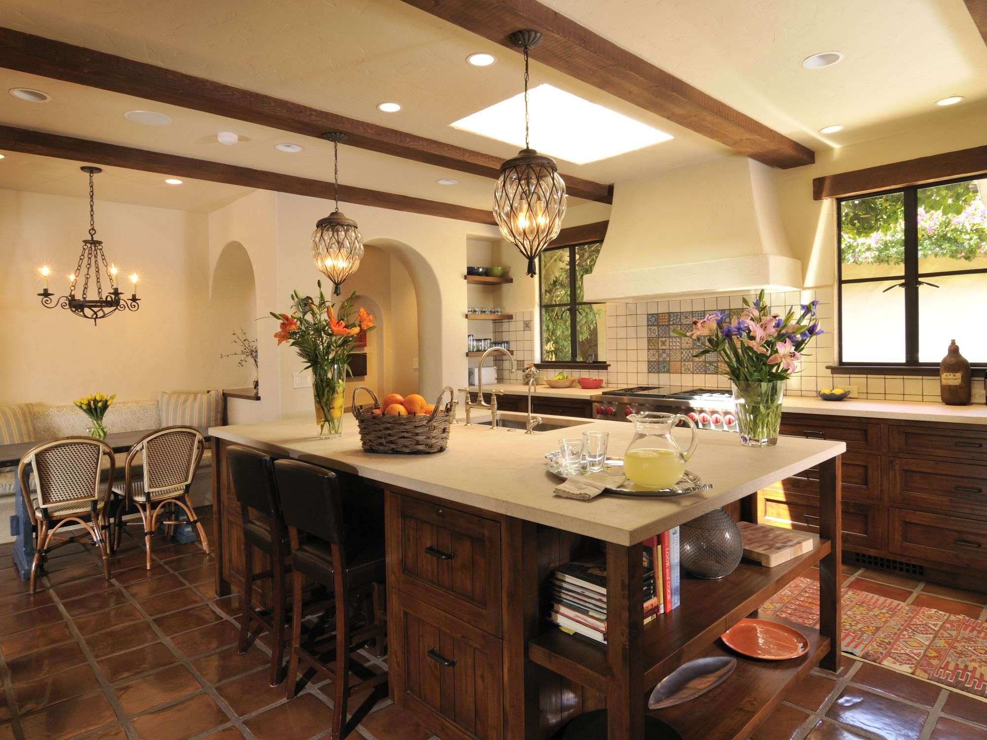 Spanish Revival Style Kitchen Remodel With Terracotta Floors, Dark Wood  Cabinets, Plaster Hood, Tiled Walls, Wood Beams, Metal Windows.