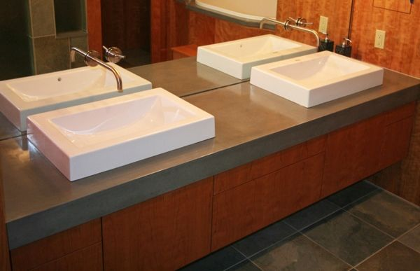 Sleek Concrete Countertops In Bathroom With Top Mount Sinks Concrete Bathroom Concrete Countertops Bathroom Bathroom Vanity Tops