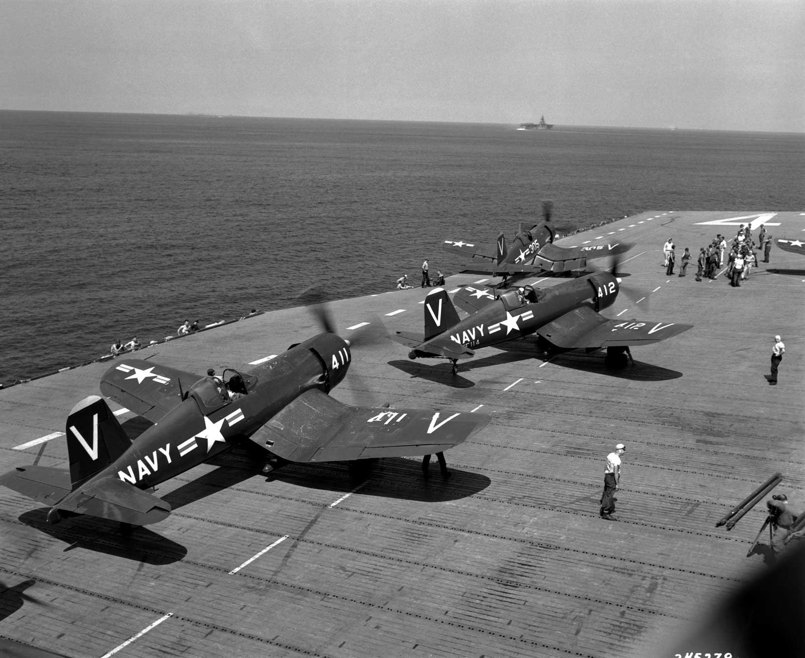 U.S. Navy Corsair fighters prepare to take off from the