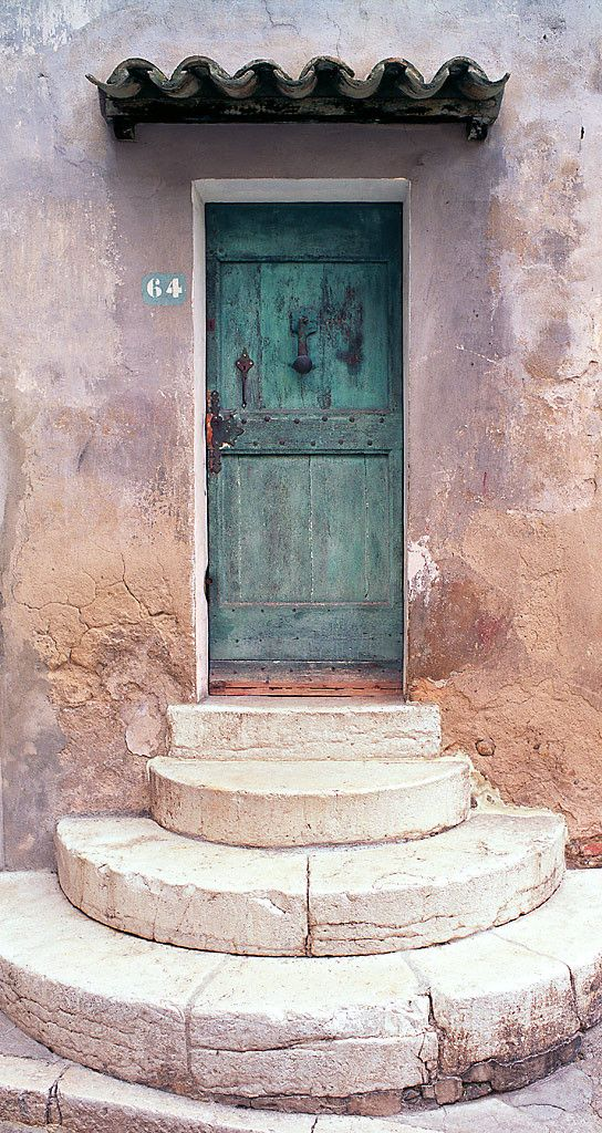 love the circular step leading to the honey blue door.. with a little eyebrow covering