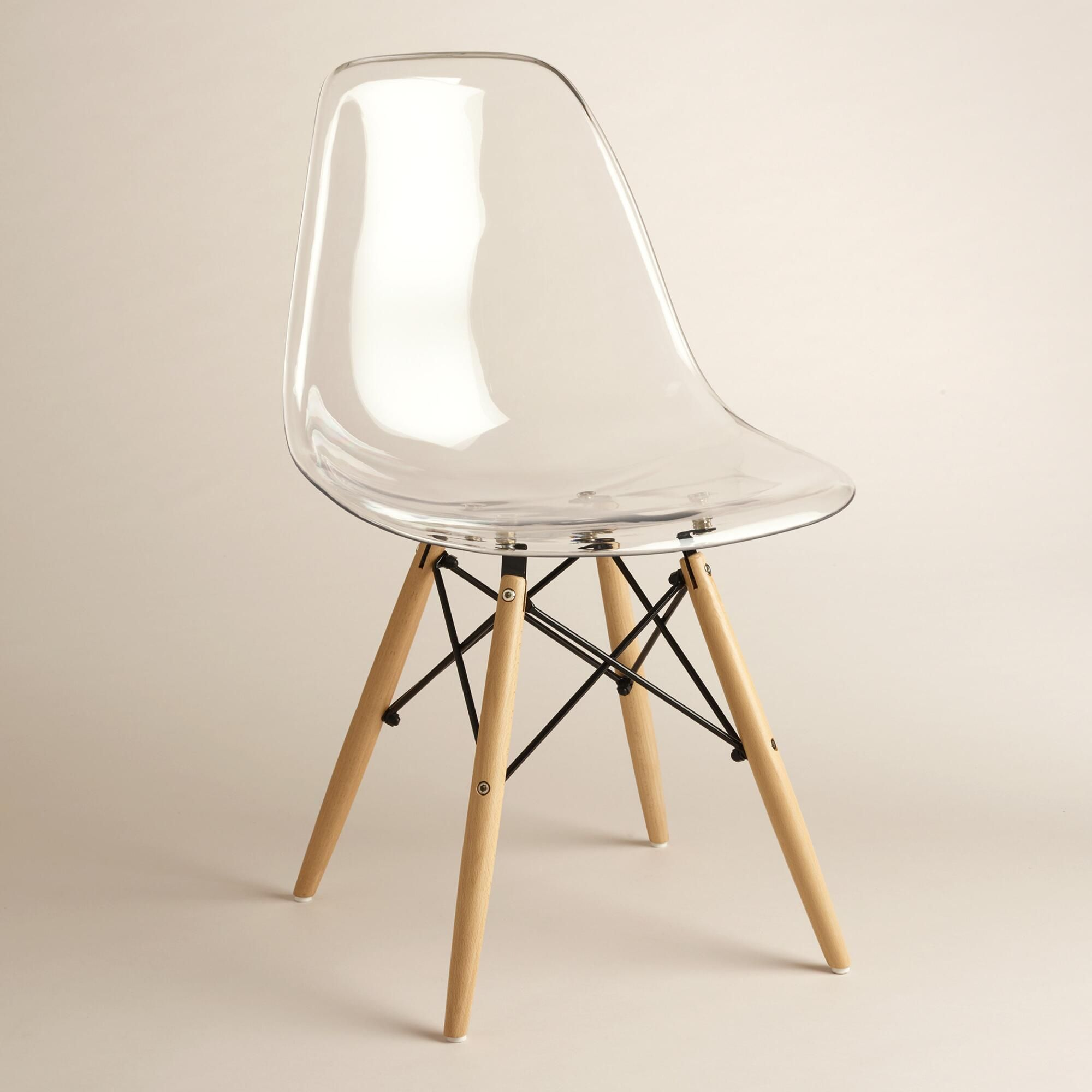 Modern aesthetic and a sculptural look our clear chairs have comfortable molded seats with flexible backs and rounded edges worldmarket home