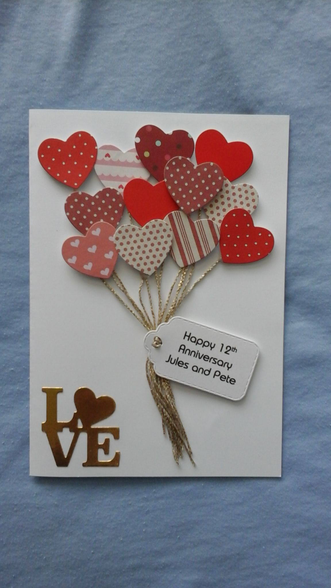 Die cut hearts with gold strings. Die cut label with computer ...