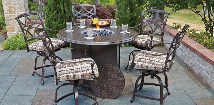 Round dining with fire pit center.