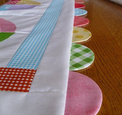 Riley Blake Bullseye Baby Quilt - love these scallops on the edge ... : quilt borders and bindings - Adamdwight.com