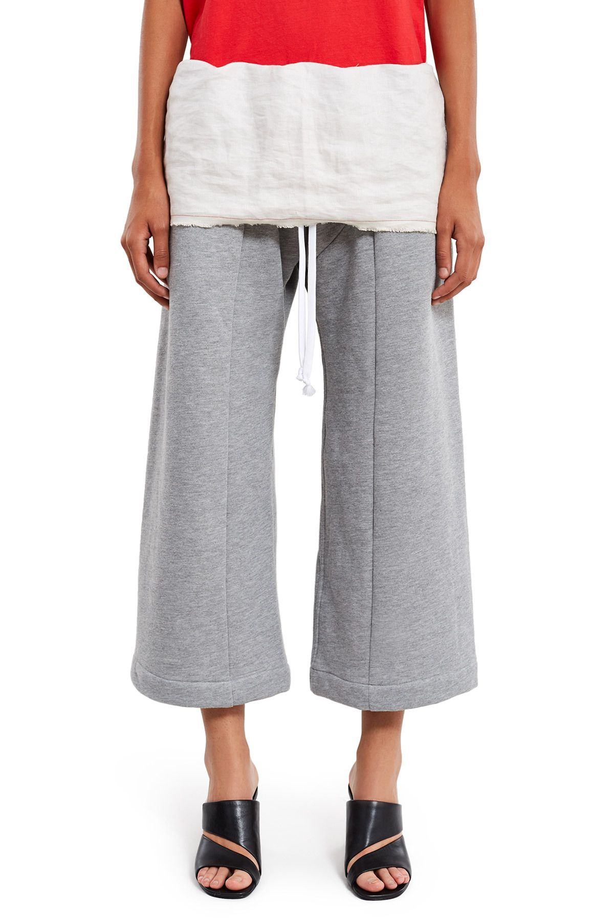 :Asymmetrical fly:Elasticated drawstring waistband:Linen waist panel with printed garment instructions:Side pockets:Wide-leg, cropped style:100% cotton; 100% linen:Imported