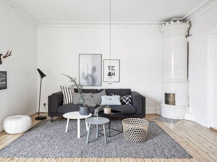 salon scandinave blanc amnag avec un canap gris graphite un tapis gris clair et trois - Tapis Gris Clair Salon