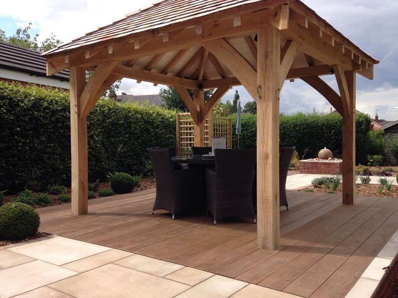 After photo the stunning bespoke oak gazebo with cedar for Garden decking with gazebo