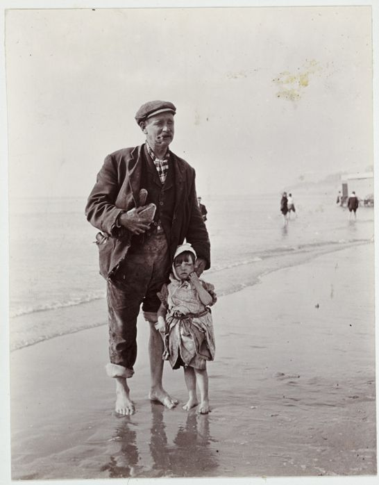Man and small child paddling in the sea, c.1910, National Media Museum Collection