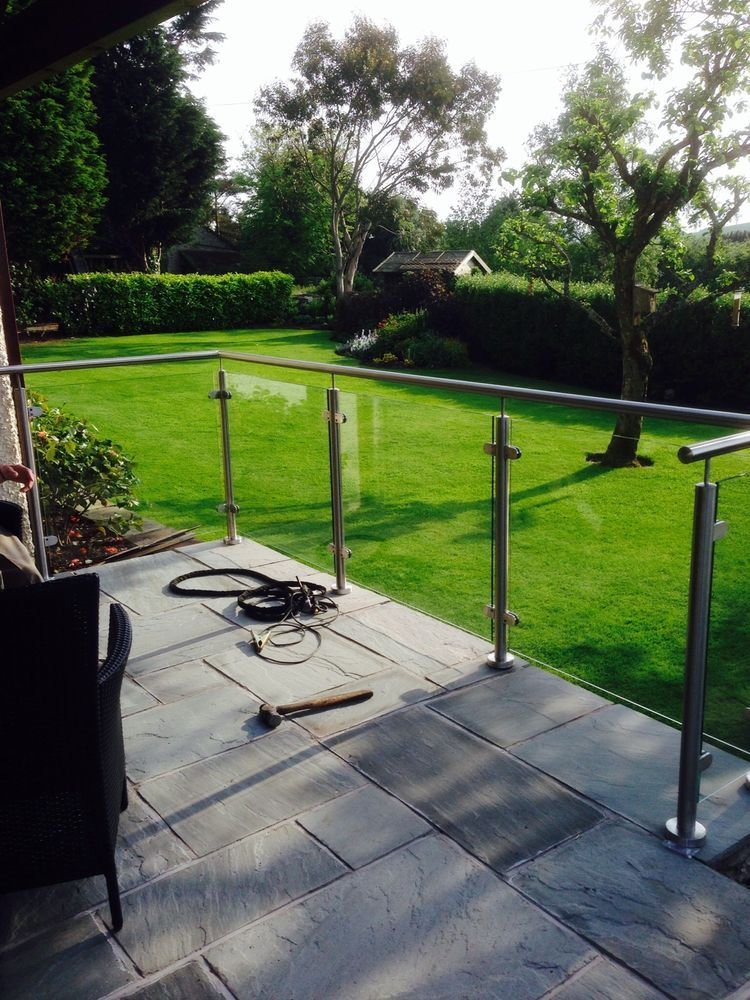 Stainless steel and glass balcony in garden patio for Garden decking and fencing