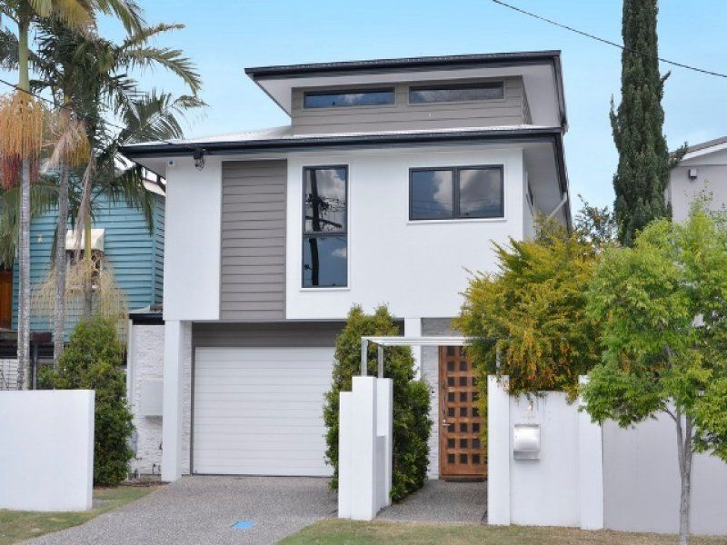 Modern House Windows concrete modern house exterior with brick fence & window awnings