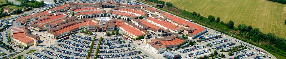 Serravalle designer outlet is located about halfway for Serravalle designer outlet milan