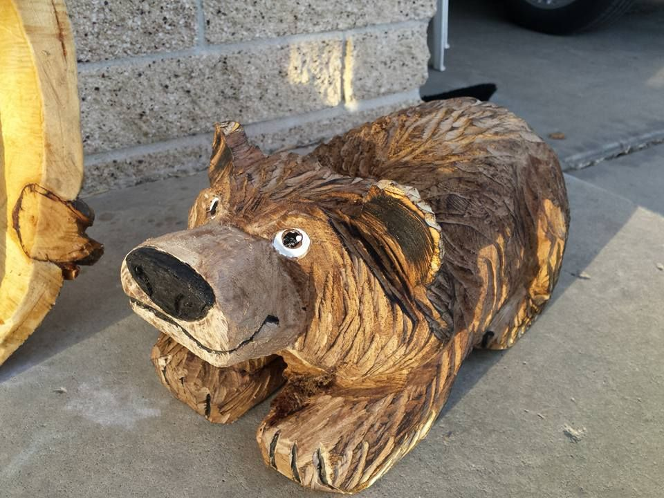Cute lil guy for the front porch :)  Hand carved (well kinda, hand carved with a Chainsaw!) solid wooden bear made in the beautiful Wasatch Mountains in Utah.  Interested in buying him?