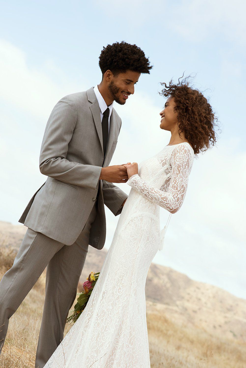 This long sleeve lace sheath wedding dress is great for a boho