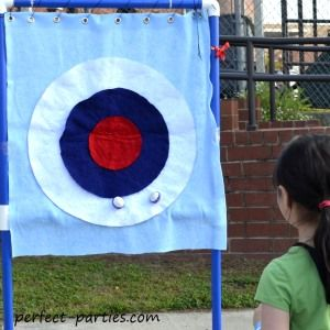 Kids Carnival Game Ideas for Birthday Parties - Bull's eye made out of felt and balls with a stripe of velcro.