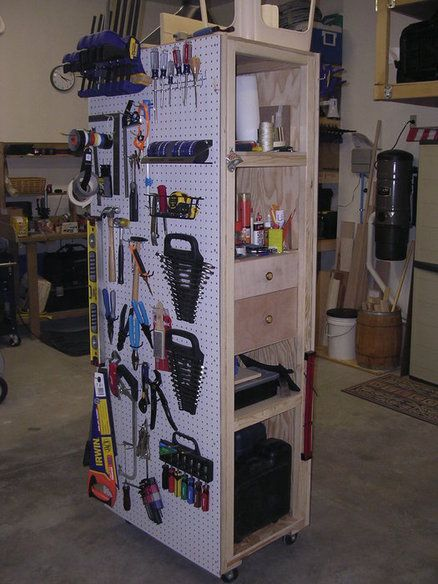 Mobile Pegboard Cabinet - by Mark Whitsitt @ LumberJocks.com ~ woodworking community. I like Mark's idea of using the furniture dolly but in my experience, make sure you grease up the bearings before mounting it. They tend to corrode in my attached garage over time....