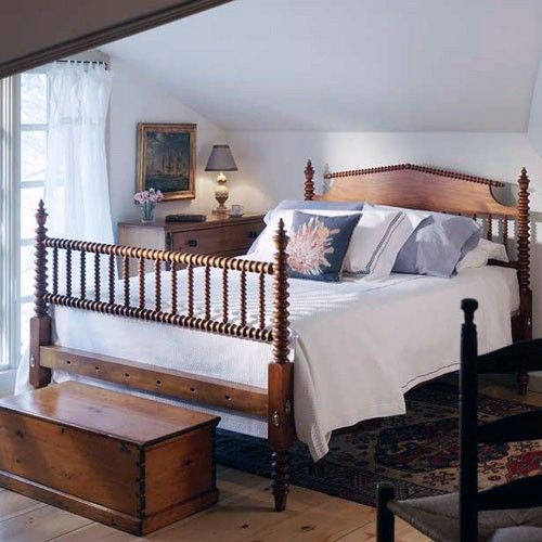 A Spool bed, similar to the one pictured here, could be found in most homes  throughout New England in the late 19th century. Our timeless and appealing  reproduction Hazel Spool bed is offered here in Spanish Cedar with a  spool-turned spindle headboard and spool-ladder foot rail. Shown here in  traditional finish. Available as a complete bed or as a headend only. This  bed also looks great in a painted finish!  SKU:SPOOL