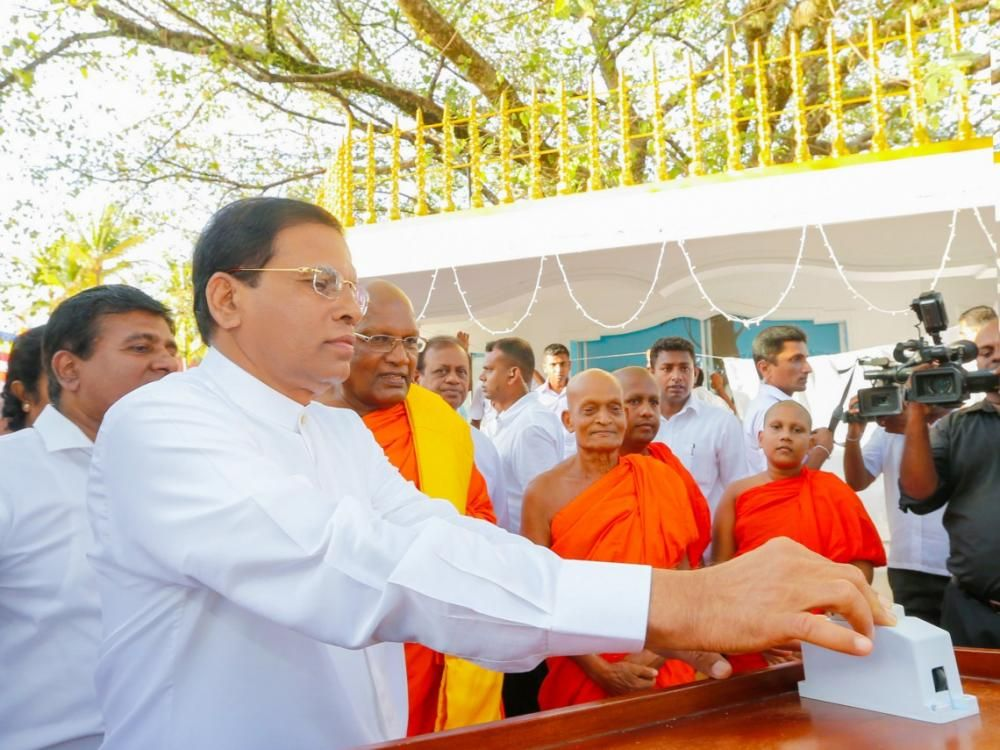 Sirisena says no removal of Buddhism clause from constitution | Tamil Guardian - Let  him step down and allow the Monk to rule the country to worst situation