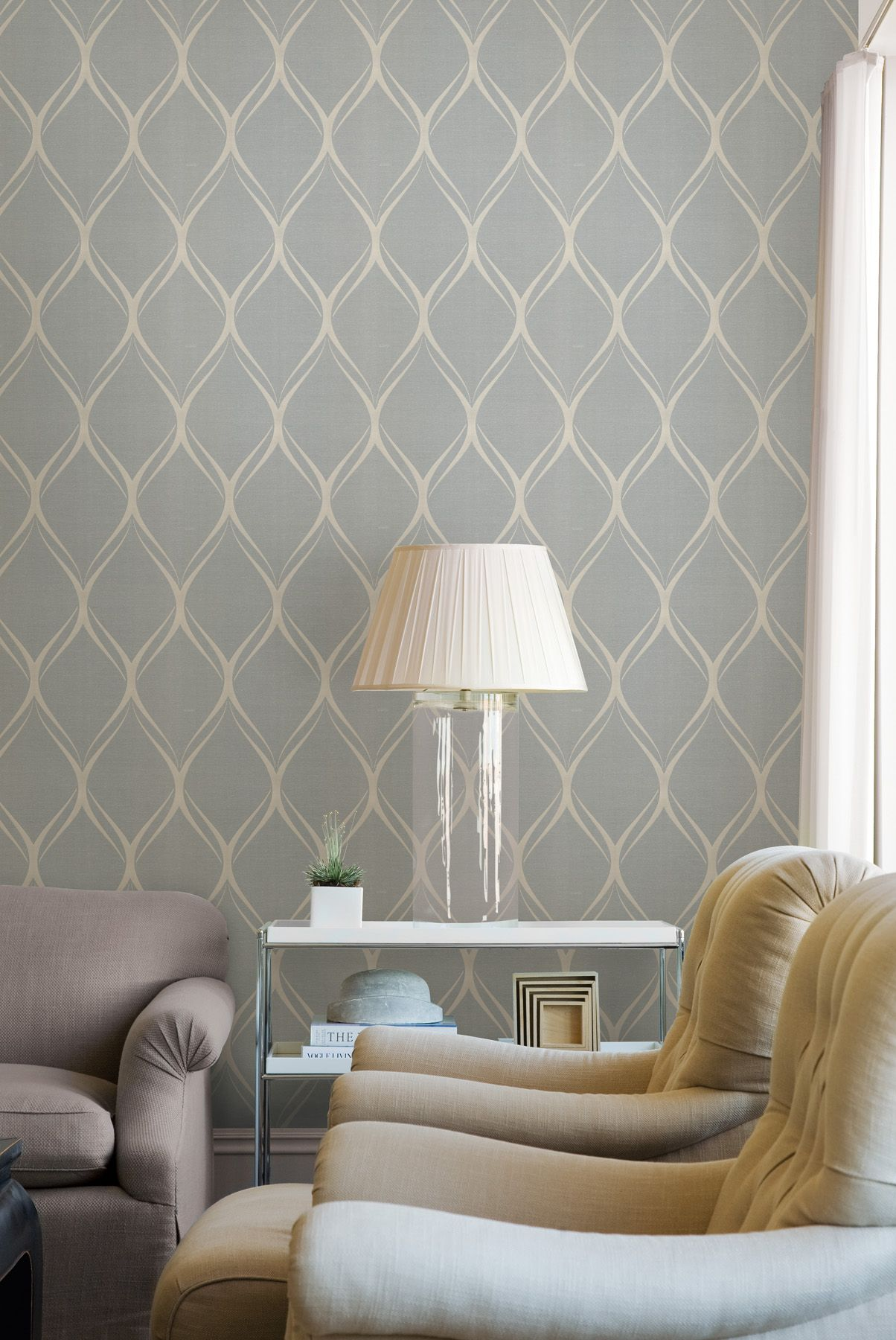 A beautiful living room with a chic feature wall wallpaper