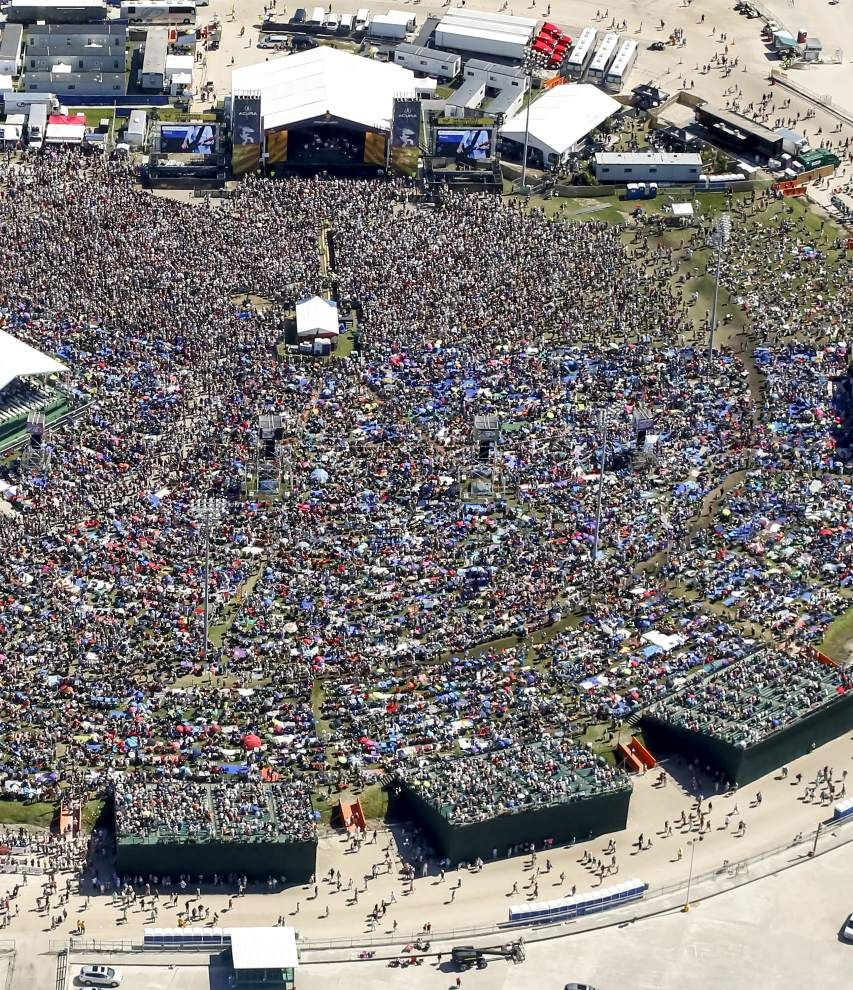 From above: Music fans pack the New Orleans Jazz and Heritage Festival, including on new bleachers at the Acura Stage.