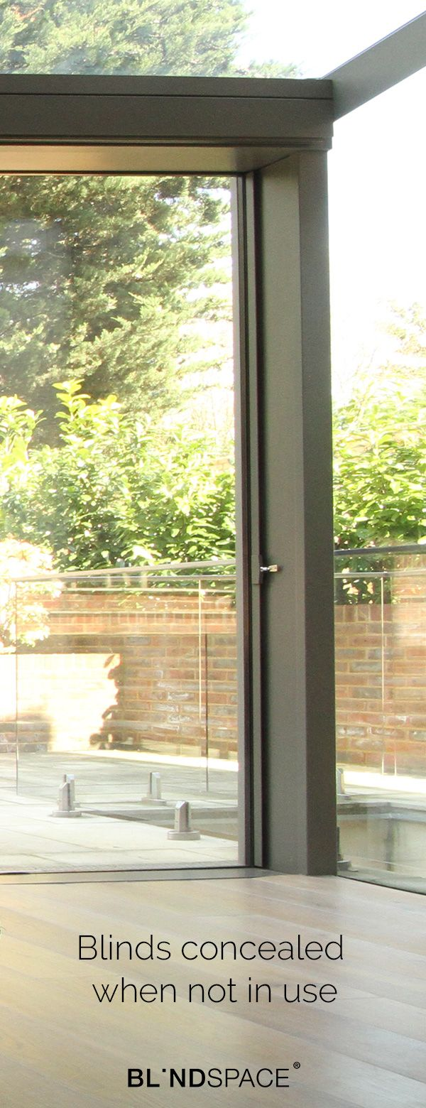 Concealed honeycomb duette blinds in sliding doors shaped window