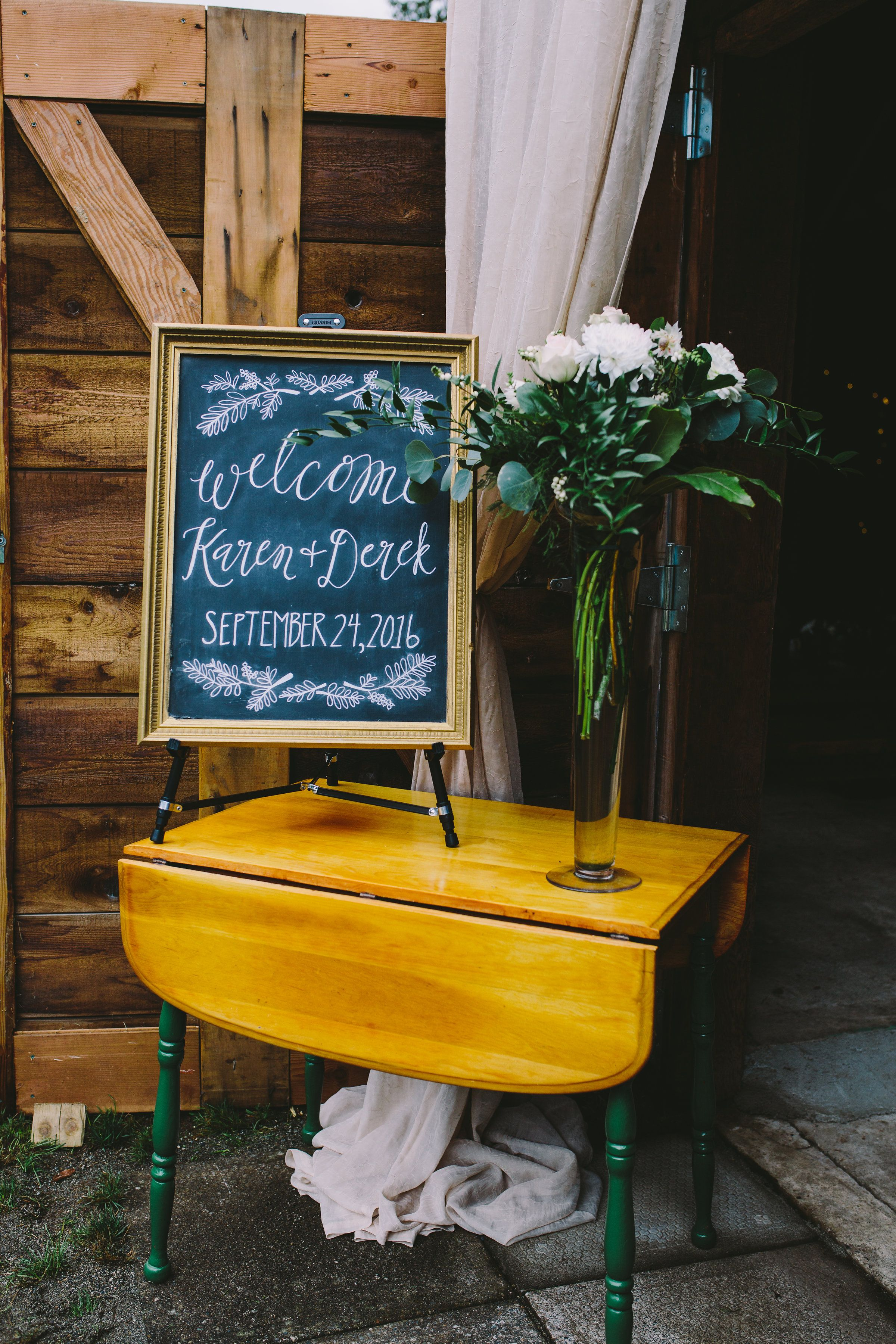 Swoon worthy barn ceremony greenery candle light calligraphy and