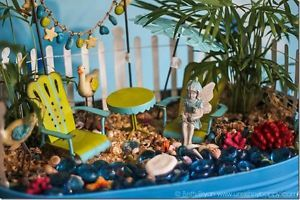 Love this beach themed fairy garden!