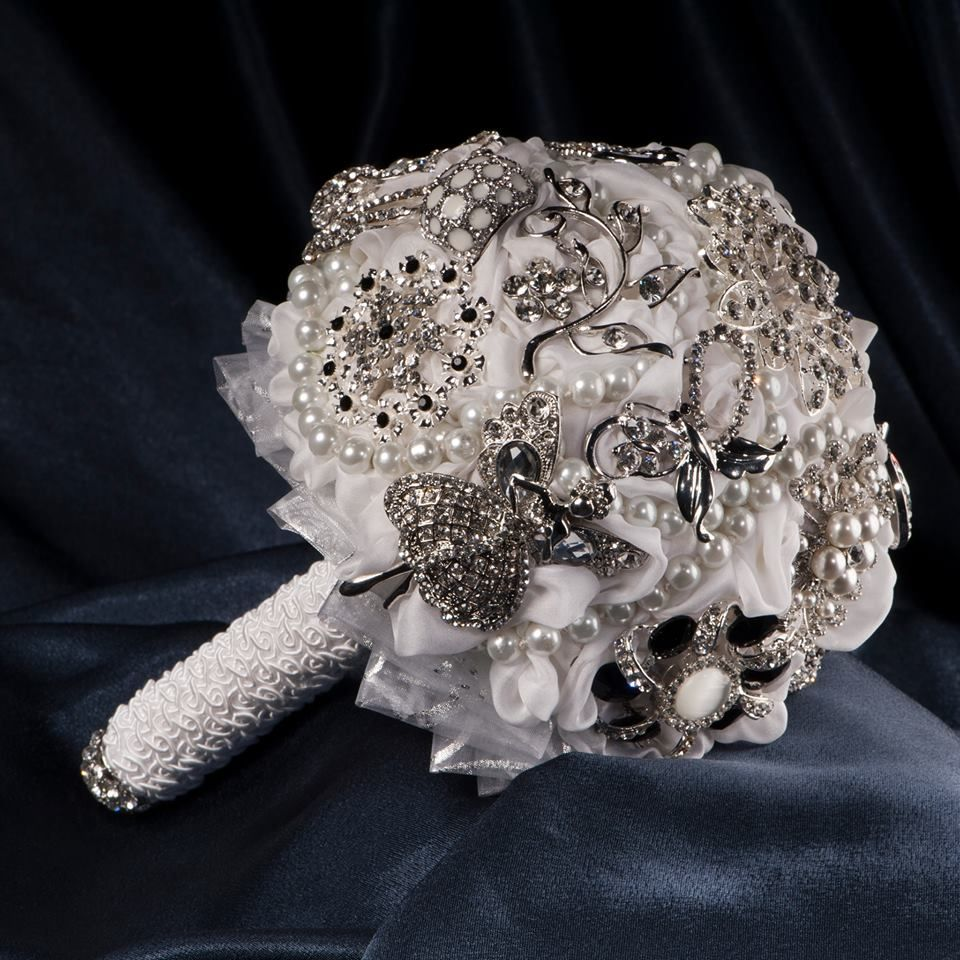 Bouquet made from white  silk,lace and brooches.