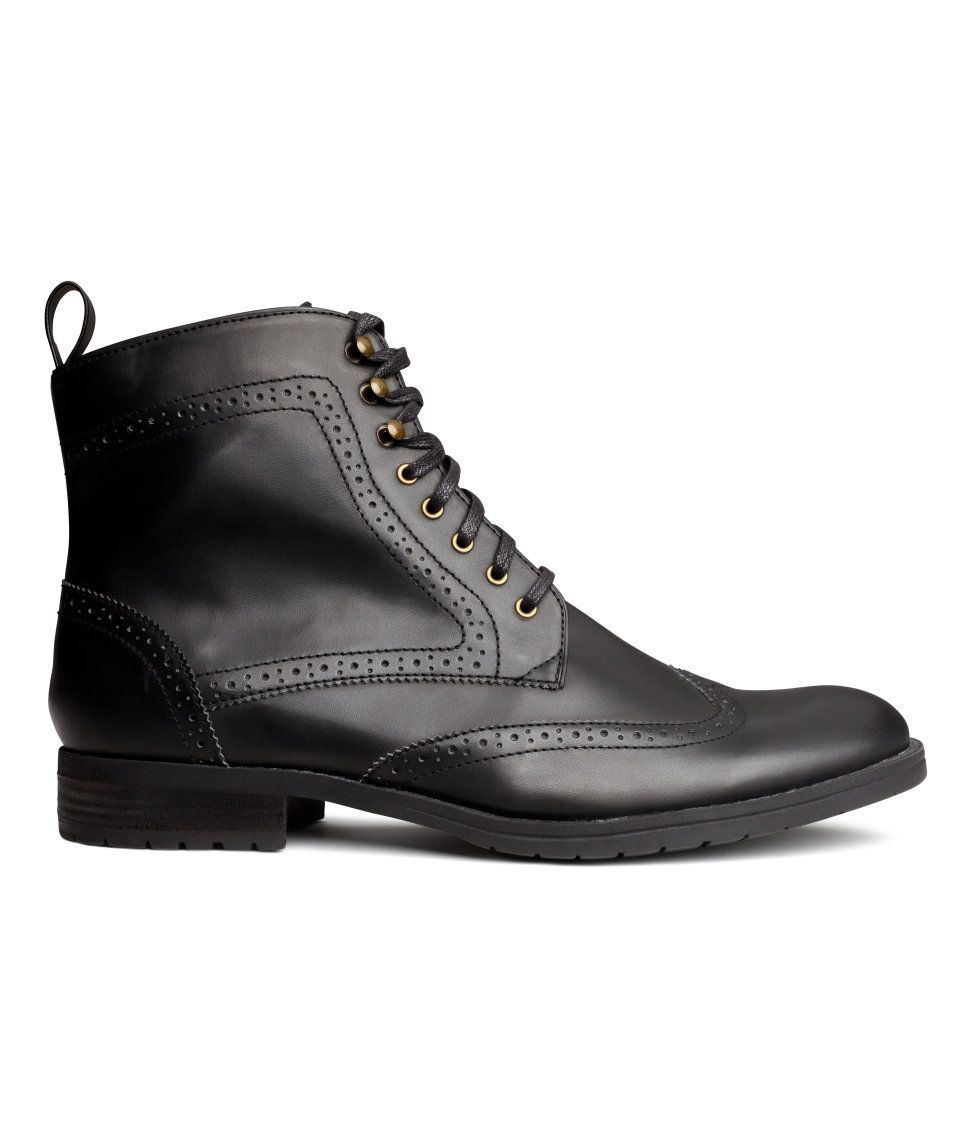 boots in black faux leather with broguestyle detail