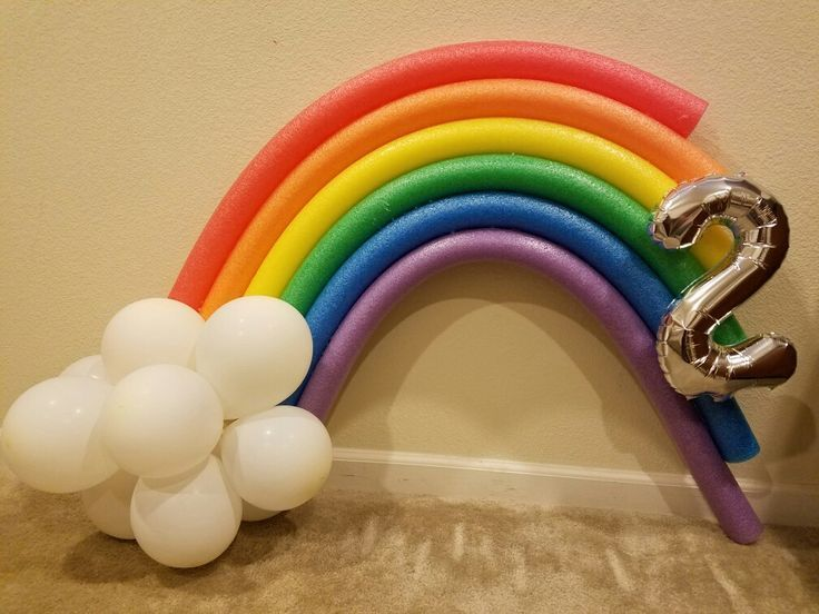 Rainbow pool noodle decoration for 2 year olds birthday