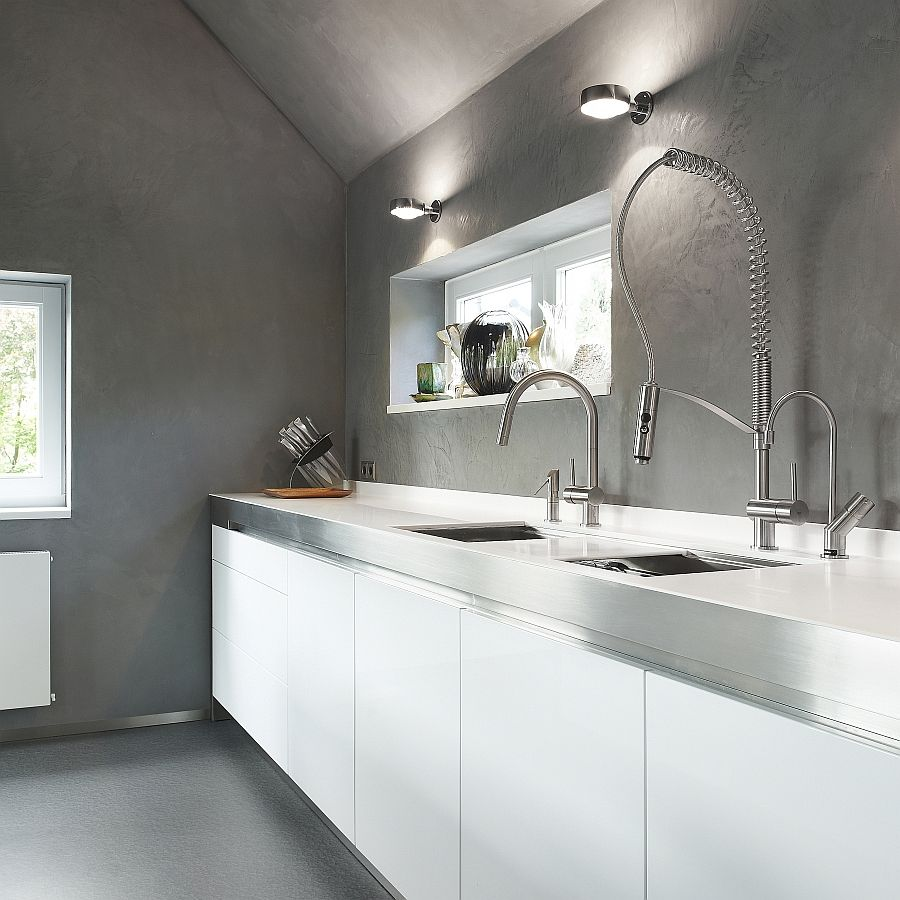 The Unfinished Concrete Backdrop Elevates The Appeal Of The Kitchen Faucet
