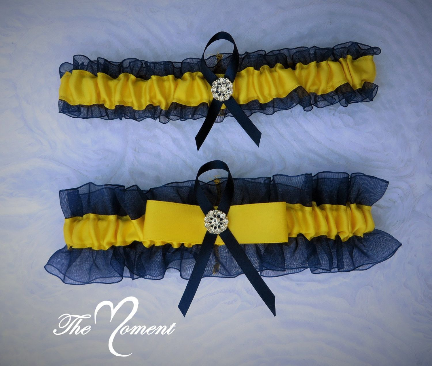 f14ad2513 Beautiful Keepsake garter as well as a Toss-away garter in Navy Blue  Organza and Yellow Satin accented with a sparkling rhinestone brooch.
