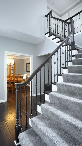 Stairway Features Iron Balusters With Adjustable Knuckles And LI PROLVL  IronPro Hardware, Newel Series, Handrail, Starting Easing With Cap.