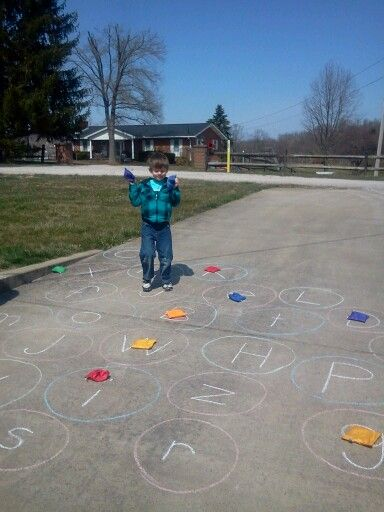My grandson throwing bean bags onto alphabet bubbles on my driveway. He would either tell me what letter it was or what he would throw it to or we would call out a letter. He loved running around looking for the letters, too. It was great. Not my idea. But I did mix upper and lower case letters. He's just 5 and did awesome!!